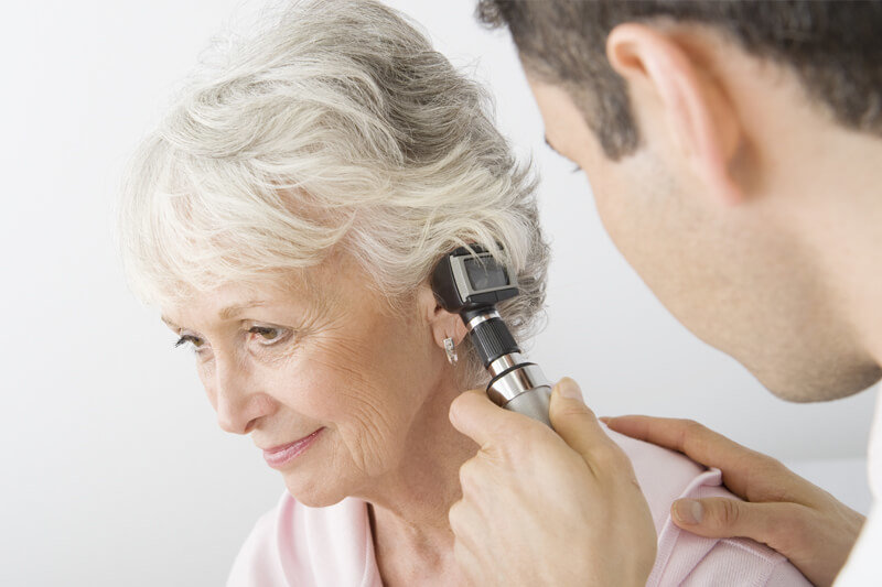 ENT Specialist using a Otoscope to look for ear drum damage