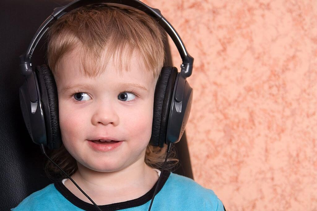 Preschool child having a hearing test wearing headphones